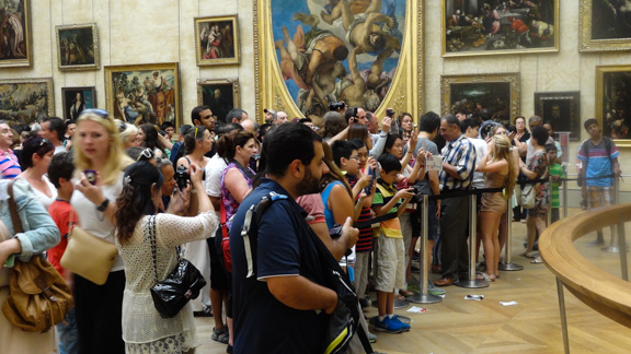 People taking pictures of the Mona Lisa. Why?