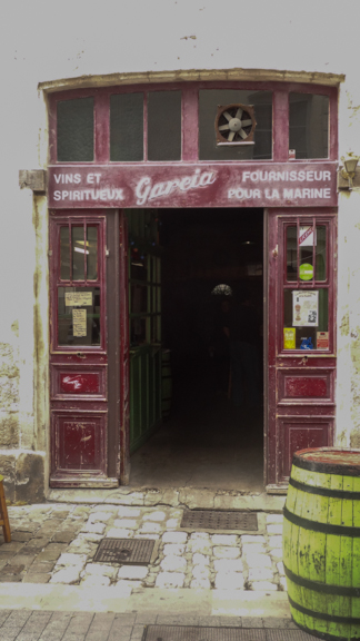"""The sign on this wine store says """"Supplier to the Navy."""" Hmmmm...."""