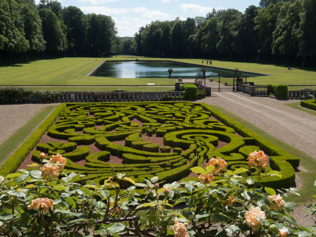A formal garden, and the main reflecting lake of the park.