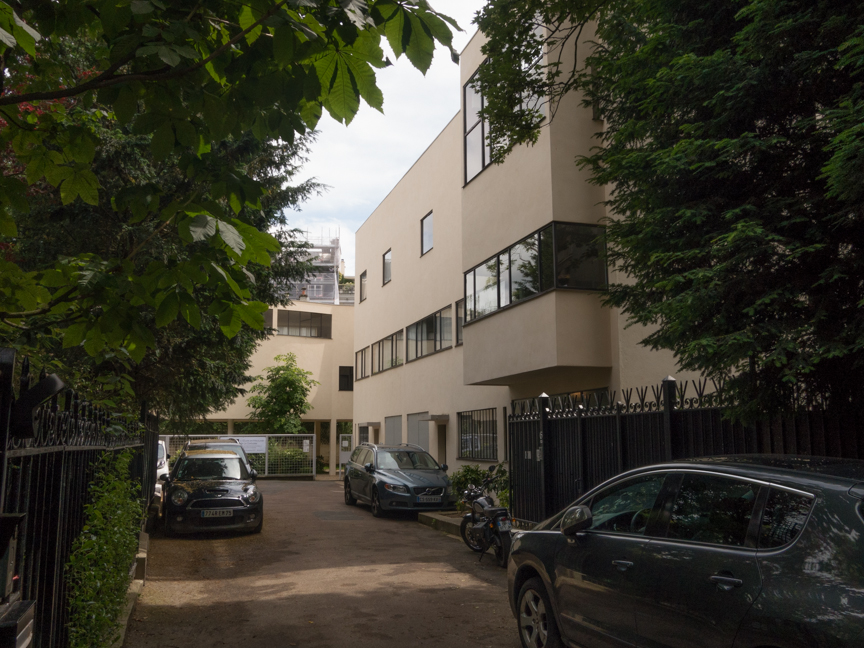 This is actually two living units, separated at where you see two garage doors. On the left was the home and exhibition rooms for Raoul Albert La Roche, a supporter of le Corbusier's Purist movement (about the only supporter) and on the right the home of le Corbusier's brother.