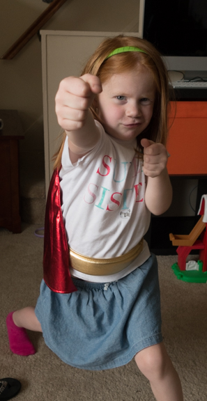 "Clara home from ""Super Hero"" day at school. She went as ""Super Sister,"" which she certainly is."