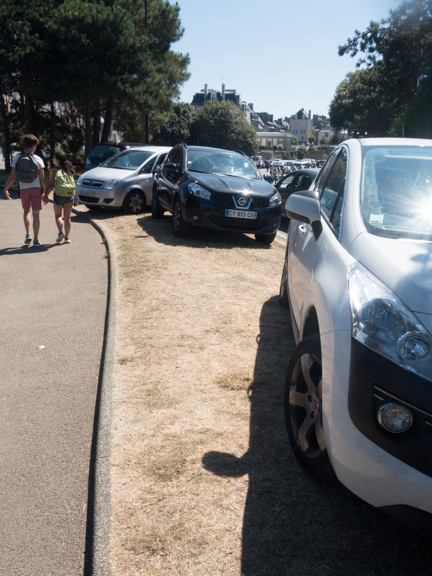 As parking disappears, drivers get creative. These cars are parked on the grassy edge of a parking lot about half a mile from St. Malo. This was the last August holiday, so these drivers did not have to worry about getting a ticket or being towed away, as the ticket-givers and tow truck drivers were all taking the day off.
